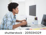 young designer working at his... | Shutterstock . vector #205034329