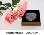 three pink roses with sterling... | Shutterstock . vector #2050429