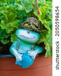 Garden Figurine Of A Frog With...