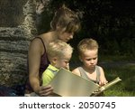 family reading a book while... | Shutterstock . vector #2050745