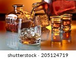 glass with whiskey and ice on a ... | Shutterstock . vector #205124719