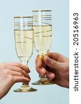 TTwo hands holding tumblers with champaign. Close-up - stock photo