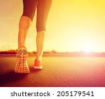 a woman with an athletic pair... | Shutterstock . vector #205179541