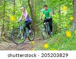 young spoty active cople biking ... | Shutterstock . vector #205203829