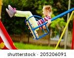 happy little girl swinging on... | Shutterstock . vector #205206091
