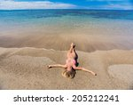 beautiful woman relaxing on... | Shutterstock . vector #205212241
