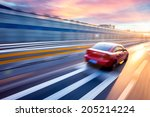 Stock photo car driving on freeway at sunset motion blur 205214224