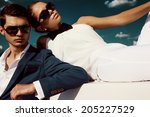 sexy couple in sunglasses | Shutterstock . vector #205227529