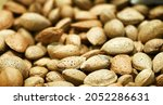 Tasty fresh almond nuts, background, texture. Selective focus. High quality photo