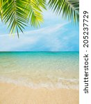 palm leaves over a golden shore | Shutterstock . vector #205237729