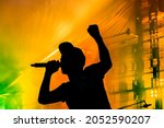 Silhouette Of A Male Singer...