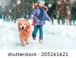 Stock photo beautiful little girl with her dog on the snow in winter 205261621