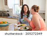 two overweight women on diet... | Shutterstock . vector #205272349