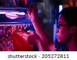 guangzhou  china   june 24. man ... | Shutterstock . vector #205272811