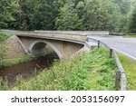 Stone Bridge Crosses A Stream...