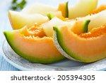 Cantaloupe Melon Slices On Blu...