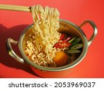 people using chopsticks to eat...