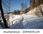 Small photo of Trodden through the snow is a narrow straight path to the temple, which is located next to the springs. Outdoor activities in winter, holy springs and clean water