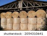 Fresh Bales Of Hay Lie In A...