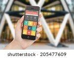 female hand holding black...   Shutterstock . vector #205477609