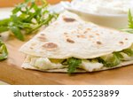 piadina with arugula and cheese | Shutterstock . vector #205523899