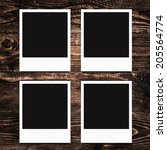 blank photo frames on wood... | Shutterstock . vector #205564774