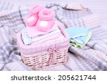 baby clothes in basket on plaid ... | Shutterstock . vector #205621744
