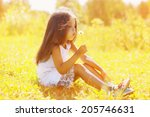 Little Child Blowing Dandelion...