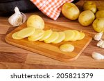 sliced new potatoes on a... | Shutterstock . vector #205821379