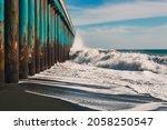 Big Waves Crash On The Pier  A...