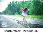 beautiful girl jumps in a... | Shutterstock . vector #205835887
