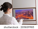 happy young woman watching tv... | Shutterstock . vector #205839985