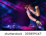 attractive young dj playing on... | Shutterstock . vector #205859167