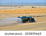 Small photo of BAKERSFIELD, CA-JULY 18, 2014: This water truck is kept busy during the project to widen State Route 178 so that airborne dust is held to a minimum.