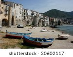 Beach in Cefalu, popular touristic village at the island of Sicily in Italy - stock photo