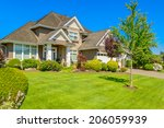 luxury house at sunny day in... | Shutterstock . vector #206059939