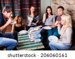 friends eating pizza together | Shutterstock . vector #206060161