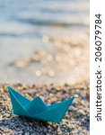 Blue Paper Boat On The Beach At ...