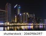 Small photo of Dubai, UAE - May 31, 2019: The night view of Dubai Marina promenade and Rove and Wyndham hotels.