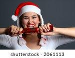 Brunette Wearing A Santa Hat...