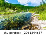 Small photo of Wild river water in mountain forests. River in moutnains. Mountain river wild