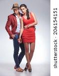 fashion couple posing on gray... | Shutterstock . vector #206154151