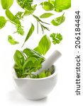 green herbs falling into mortar ... | Shutterstock . vector #206184484