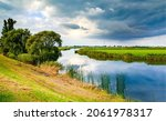 Small photo of On the bank of a rural river. Rural river landscape. River shore. River outdoors