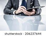 business report and man hand.... | Shutterstock . vector #206237644