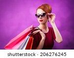 redhead women with shopping... | Shutterstock . vector #206276245