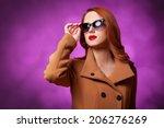 redhead women in coat on violet ... | Shutterstock . vector #206276269