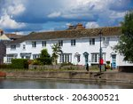 Row Of Riverside Cottages Make...