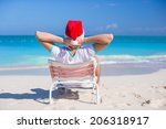 back view of young man in santa ... | Shutterstock . vector #206318917