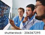 young male doctors looking... | Shutterstock . vector #206367295